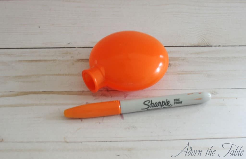 Orange disc and orange sharpie for pumpkin place card holder.